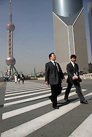 Pedestrians walking in the Pudong Financial District of Shanghai, China. One of China's policy banks, the China Development Bank, has plans to grant 30 billion RMB (Euro 3 Billion) in loans to Pudong as a part of the country's 11th Five-Year Program. .