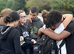 Hugs and tears from friends of Justin Brady, including John Jackson, right, outside the courthouse during arraignment for Shyhiem Adams at Enfield Superior Court on charges in the stabbing death of 16-year-old of Justin Brady, Tuesday, Sept. 11, 2018, in Enfield, Conn. One person was arrested. (Jim Michaud/Journal Inquirer via AP, Pool)