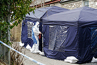 """Pictured: Police and forensics officers at the house in Aberaeron, where the remains of a woman have been discovered in Ceredigion County, Wales, UK. Wednesday 21 March 2018<br /> Re: Human remains have been found in a house following a police investigation to find a missing woman.<br /> Police were called to the property in Aberaeron, west Wales after a woman in her 50s collapsed.<br /> Police also discovered the woman's mother, in her 80s, who had not been seen for some time.<br /> The women were named locally as Gaynor and Valerie Jones, with police currently treating the death as unexplained.<br /> The two women have ben described as """"reclusive"""" by neighbours and the home they shared as being """"heavily cluttered""""."""