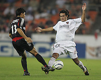 30 October,  2004.   DC United's Christian Gomez (13) tries to pass the ball past Gilberto Flores (25) of the MetroStars during the 2004 MLS playoffs at RFK Stadium in Washington, DC.