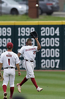 Arkansas outfielder Christian Franklin (25) forces an out, Monday, June 7, 2021 in the second inning of the NCAA Fayetteville Regional at Baum-Walker Stadium in Fayetteville. Check out nwaonline.com/210608Daily/ for today's photo gallery. <br /> (NWA Democrat-Gazette/Charlie Kaijo)