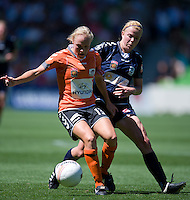 MELBOURNE, AUSTRALIA - DECEMBER 4: Amy JACKSON from Melbourne Victory and Tameka Butt of the Roar compete for the ball in round 5 of the Westfield W-league match between Melbourne Victory and Brisbane Roar on 4 December 2010 at AAMI Park in Melbourne, Australia. (Photo Sydney Low / asteriskimages.com)
