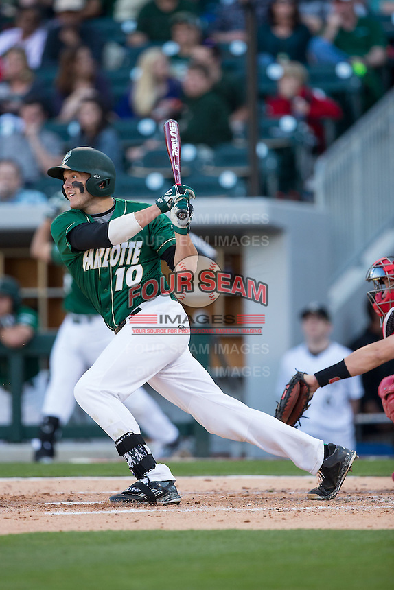 Zach Jarrett (10) of the Charlotte 49ers follows through on his swing against the North Carolina State Wolfpack at BB&T Ballpark on March 31, 2015 in Charlotte, North Carolina.  The Wolfpack defeated the 49ers 10-6.  (Brian Westerholt/Four Seam Images)