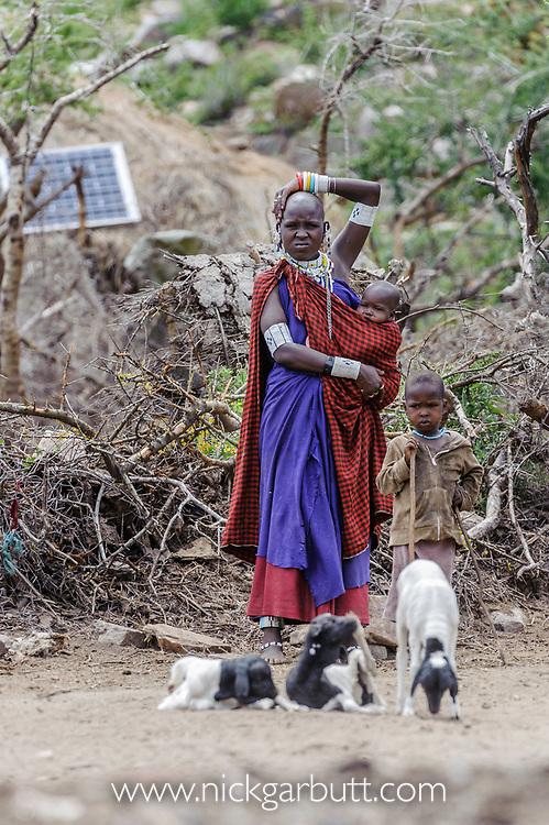 Masaai / masai woman with child. Ngorongoro Conservation Area / Serengeti National Park, Tanzania. March 2014.