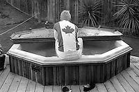 Bergen Wilde sitting in the hot tub, 1987. &#xA;<br />