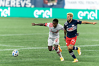 FOXBOROUGH, MA - OCTOBER 7: Richie Laryea #22 of Toronto FC and Diego Fagundez #14 of New England Revolution chase down a loose ball during a game between Toronto FC and New England Revolution at Gillette Stadium on October 7, 2020 in Foxborough, Massachusetts.