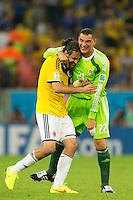 Mario Yepes of Columbia celebrates with goalkeeper Faryd Mondragon of Columbia