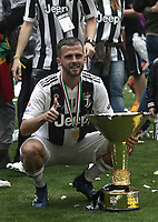 Calcio, Serie A: Juventus - Hellas Verona, Torino, Allianz Stadium, 19 maggio, 2018.<br /> Juventus' Miralem Pjanic celebrates with the trophy during the victory league ceremony at Torino's Allianz stadium, 19 May, 2018.<br /> Juventus won their 34th Serie A title (scudetto) and seventh in succession.<br /> UPDATE IMAGES PRESS/Isabella Bonotto