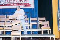 A man stacks chairs after Texas senator and Republican presidential candidate Ted Cruz spoke at a town hall put on by the Concerned Veterans for American at Milford Town Hall in Milford, New Hampshire.