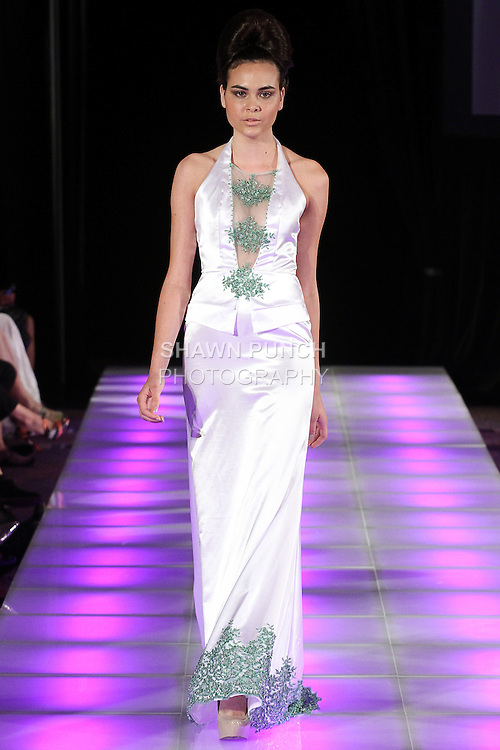 Model walks runway in an outfit from the Andres Aquino Spring Summer 2015 collection, during Couture Fashion Week Spring 2015, in New York City.