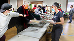 "NAUGATUCK CT. - 25 December 2020-122520SV03-About 75 volunteers along with Mayor N.Warren ""Pete"" Hess, center, fill bags with Christmas dinner to be delivers to familys in need at St. Michaels Church in Naugatuck Friday.<br /> Steven Valenti Republican-American"