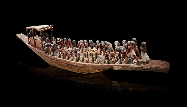 Ancient Egyptian model of a funerary boat with oarsman and a sarcopagus under a canope, Middle Kingdom (1980-1700 BC. Egyptian Museum, Turin. Cat 1209. black background.<br /> <br /> Funerary boats were probably believed to carry the deceased sould to the afterlife. Wooden tomb models were an Egyptian funerary custom throughout the Middle Kingdom in which wooden figurines and sets were constructed to be placed in the tombs of Egyptian royalty.