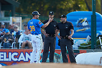 Myrtle Beach Pelicans manager Steve Lerud (39) argues with umpire Mark Bass as home plate umpire Jake Bruner looks on after having been ejected from the game against the Winston-Salem Dash at TicketReturn.com Field on May 16, 2019 in Myrtle Beach, South Carolina. The Dash defeated the Pelicans 6-0. (Brian Westerholt/Four Seam Images)