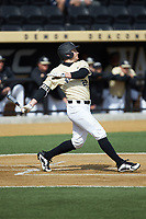 Michael Ludowig (22) of the Wake Forest Demon Deacons follows through on his swing against the Louisville Cardinals at David F. Couch Ballpark on March 18, 2018 in  Winston-Salem, North Carolina.  The Demon Deacons defeated the Cardinals 6-3.  (Brian Westerholt/Four Seam Images)
