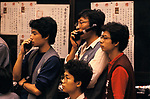 Hong Kong Gold Exchange 1990s. Traders dealers on their mobile phones old fashioned i phones stock exchange floor in the China 1991 1990s