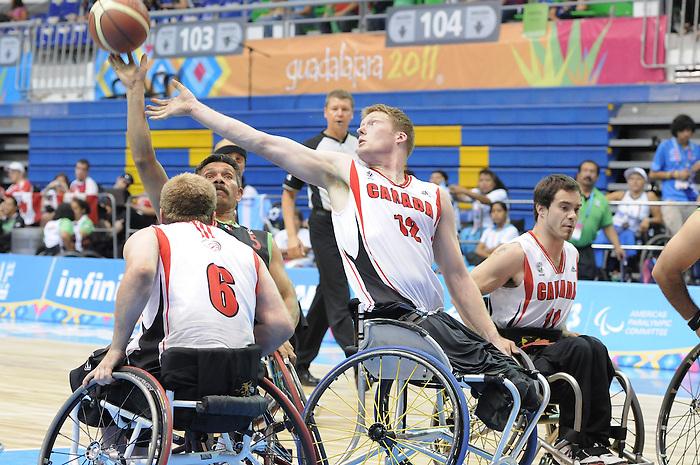 Bo Hedges and Chad Jassman, Guadalajara 2011 - Wheelchair Basketball // Basketball en fauteuil roulant.<br /> Team Canada competes in the bronze medal game // Équipe Canada participe au match pour la médaille de bronze. 11/18/2011.
