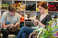 STAFF PHOTO ANTHONY REYES • @NWATONYR<br /> Katharine Arthurs, left, of Springdale, and Geneva Stewart, of Fayetteville, crochet and knit Thursday, Sept. 18, 2014 during a class at Mockingbird Moon in Rogers. Arthurs is crocheting a dishcloth while Stewart is knitting one.