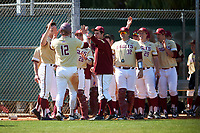 Boston College Eagles Scott Braren (12) high fives teammates - including Aaron Soucy (28), Jake Goodreau (32), and Sean Hughes (29) - after scoring a run during a game against the Central Michigan Chippewas on March 3, 2017 at North Charlotte Regional Park in Port Charlotte, Florida.  Boston College defeated Central Michigan 5-4.  (Mike Janes/Four Seam Images)
