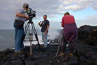 Camera crew at the sea cliff, Ocean entry lava flow, Kilauea volcano, Hawaii, USA Volcanoes National Park, The Big Island of Hawaii, USA