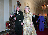 Washington, DC - November 9, 2000 -- United States President Bill Clinton, center, escorts former first lady Lady Bird Johnson, left, and current first lady Hillary Rodham Clinton, right, to the 200th Anniversary of the White House Dinner in Washington, D.C. on November 9, 2000. Also visible at right are former U.S. President Gerald R. Ford, former first lady Betty Ford, and former U.S. President George H.W. Bush and former first lady Barbara Bush.<br /> Credit: Ron Sachs / CNP