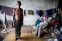 When Cyclone Nargis hit the Irrawaddy Delta on 02/05/2008, 68 year old U Hla Tin, who is paralysed down his left side, was still able to carry his 60 year old wife to safety. Mr. Tin hasn't been back to his home. He doesn't believe his neighbours when they say that his hut has been destroyed. He and his wife now live alongside other refugees from the 7th ward, Hlaingthaya township in Rangoon (Yangon), in the Shwe Than Lwin shopping complex, which is under construction and has acted as a small refugee centre.