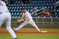 Pensacola Blue Wahoos first baseman Caleb Hamilton (24) stretches for a throw during a Southern League game against the Biloxi Shuckers on May 3, 2019 at Admiral Fetterman Field in Pensacola, Florida.  Pensacola defeated Biloxi 10-8.  (Mike Janes/Four Seam Images)