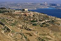 Gozo, Malta.  View of Comino Island from Qala, Gozo.  Malta in far distance.