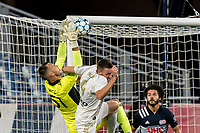 FOXBOROUGH, MA - AUGUST 5: Joe Rice #51 of New England Revolution II makes a save as Max Flick #4 of North Carolina FC attempts to head the ball during a game between North Carolina FC and New England Revolution II at Gillette Stadium on August 5, 2021 in Foxborough, Massachusetts.