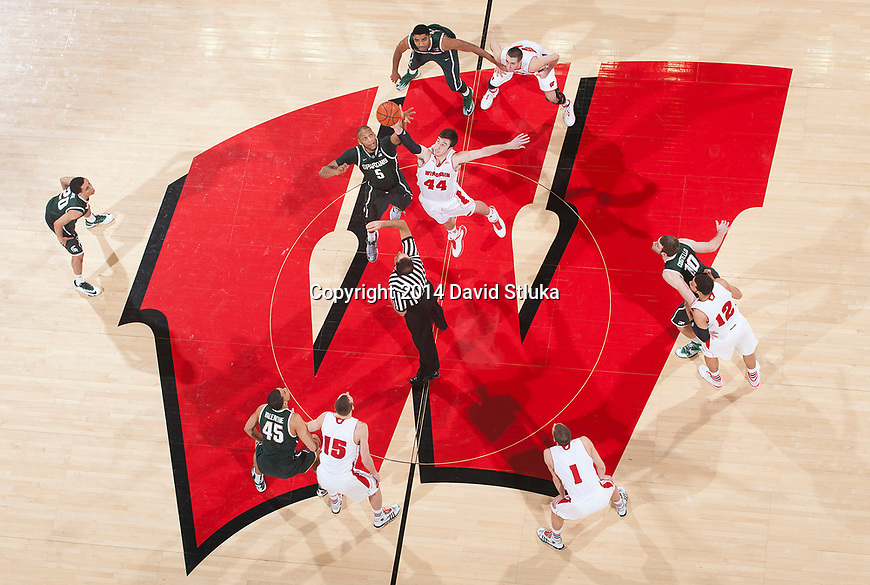 An overhead view of the opening tip-off of the Wisconsin Badgers NCAA college basketball game against the Michigan State Spartans Sunday, February 9, 2014 in Madison, Wis. The Badgers won 60-58. (Photo by David Stluka)