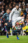 Nacho Fernandez (r) of Real Madrid is chased by Carlos Alberto Vela Garrido of Real Sociedad during their La Liga match between Real Madrid and Real Sociedad at the Santiago Bernabeu Stadium on 29 January 2017 in Madrid, Spain. Photo by Diego Gonzalez Souto / Power Sport Images