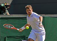 England, London, Juli 06, 2015, Tennis, Wimbledon, Stan Wawrinka (SUI) in action against David Goffin of Belgium<br /> Photo: Tennisimages/Henk Koster