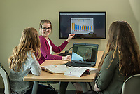 Clara Baldwin, center, Emilia Brown, left, and. Kelsey Lellig, right, photographed for UAA's College of Business.