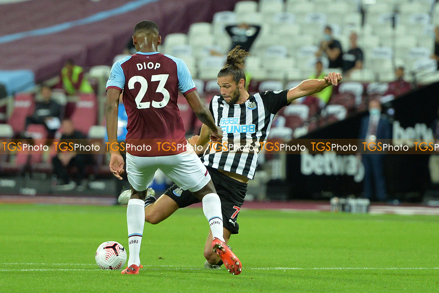 Andy Carroll of Newcastle United shot is blocked by Issa Diop of West Ham United during West Ham United vs Newcastle United, Premier League Football at The London Stadium on 12th September 2020