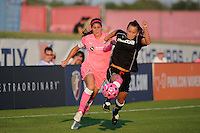 Ali Riley (3) of the Western New York Flash and Brittany Taylor (14) of Sky Blue FC battle for the ball. The Western New York Flash defeated Sky Blue FC 2-0 during a Women's Professional Soccer (WPS) match at Yurcak Field in Piscataway, NJ, on July 17, 2011.