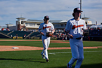 Oregon State Beavers shortstop Andy Armstrong (9) and second baseman Jake Harvey (2) jog off the field between innings of an NCAA game against the New Mexico Lobos at Surprise Stadium on February 14, 2020 in Surprise, Arizona. (Zachary Lucy / Four Seam Images)