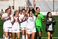 MONTCLAIR, NJ - OCTOBER 3: Katie McClure #6 of the Washington Spirit, Meggie Dougherty Howard #8 of the Washington Spirit, Devon Kerr #25 of the Washington Spirit along with teammates wave to fans in a nearby parking garage post-game during a game between Washington Spirit and Sky Blue FC at MSU Soccer Park at Pittser Field on October 3, 2020 in Montclair, New Jersey.