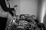 Beach Camp, Gaza: An international organization comes twice a week for physical therapy sessions in order that Nour's muscles don't shorten. They also take care of his joints and change the dressing of his wound on his shoulder that often has inflammation, the 30th October 2019. This organization comes thanks to the Salam Society for Relief & Development that has made a list of patients in Gaza that need physiotherapy at home. <br /> <br /> Beach Camp, Gaza: une organisation internationale se rend deux fois par semaine pour des séances de kinésithérapie afin que les muscles de Nour ne rétressissent pas. Ils prennent également soin de ses articulations et changent le pansement de sa plaie sur son épaule souvent enflammée, le 30 octobre 2019. Cette organisation vient grâce à Salam Society for Relief & Development qui a dressé une liste de patients à Gaza qui ont besoin de kinésithérapie à domicile.