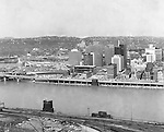 Pittsburgh PA:  View of the city's skyline.  The view includes Gateway Center and construction of the Pittsburgh Press Building.  The view also includes the clearing of the Point and the Fort Duquesne Bridge and ramp construction.