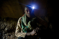 Miner before entering the deep shafts of Makala mine in noth eastern DRC. Without options for  employment the  legion of miners seek enough gold  to feed thier familes. Their days are long and spent mostly waist deep in water hammering quartz rock from the  mine shaft walls. The  rock is then brought to the surface and processed by hand to extract  the  gold.