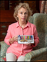 BNPS.co.uk (01202 558833)<br /> Pic: PhilYeomans/BNPS<br /> <br /> Demanding answers - Susan Bond, with some of her fathers medals she was shocked to find being sold by a London based medal dealer...the MC is a fake.<br /> <br /> Military museum in hot water over missing medals..<br /> <br /> A woman whose father and grandfather donated their highly-valuable gallantry medals to an army museum is furious they have disappeared having been suspiciously substituted for duplicates.<br /> <br /> Susan Bond, whose husband Richard is a retired crown court judge, discovered the two Military Cross groups at the The Royal Green Jackets Museum are not the ones bequeathed to them after one set appeared on the open market.<br /> <br /> Mrs Bond confronted the trustees at the museum, whose former Colonel-in-Chief was the Queen, but the 70-year-old has been left dismayed at their 'indifferent' response at the loss which they have been unable to properly explain.<br /> <br /> The owners - the museum based in Winchester, Hants - said they were satisfied that no criminal activity had taken place and the police investigation came to nothing.