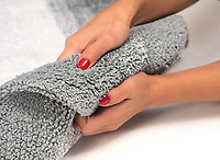 Showing the texture of a rug is important. Use of a model can bring out key features of your product.
