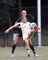 Boston College forward Victoria DiMartino (1) flips ball over defender, University of Central Florida defender Carleigh Williams (4). After two overtime periods, Boston College tied University of Central Florida, 2-2, at Newton Campus Field, September 9, 2012.