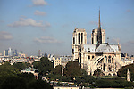 Aerial view of Notre Dame Notre-Dame cathedral from Left Bank with highrise office towers of La Defense in background. city of Paris. Paris. France
