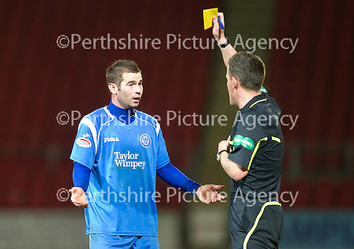 St Johnstone v Brechin....22.03.11  Scottish Cup Quarter Final replay.Peter MacDonald gets booked by Steve Conroy which means he misses the semi-final.Picture by Graeme Hart..Copyright Perthshire Picture Agency.Tel: 01738 623350  Mobile: 07990 594431