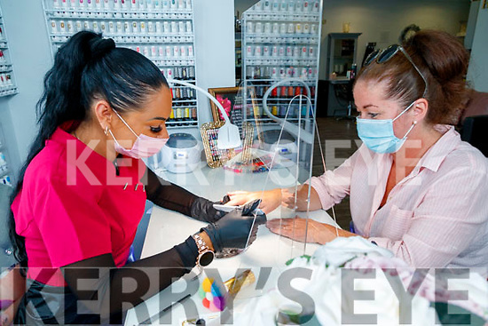 Monica Lup nail technician at the Hairworks, Tralee attending to her client Triona Hussey on Monday.