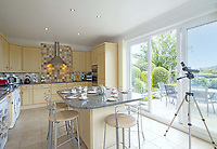 BNPS.co.uk (01202) 558833. <br /> Pic: LillicrapChilcott/BNPS<br /> <br /> Pictured: Kitchen. <br /> <br /> This impressive waterfront home with breath-taking views is the perfect property for a wannabe sailor - on the market for £2.5m.<br /> <br /> Huefield sits in an elevated position looking over the rooftops of neighbouring properties onto the beautiful Helford River in Cornwall - ideal for watching boats coming and going.<br /> <br /> The Helford Passage area is so sought after houses rarely come up for sale and this one, on the market with Lillicrap Chilcott, is the only property available there at the moment.<br /> <br /> The five-bedroom home is south facing and has a swimming pool and beautiful gardens for enjoying the view, as well as access to a gate with a right of way down to the water.
