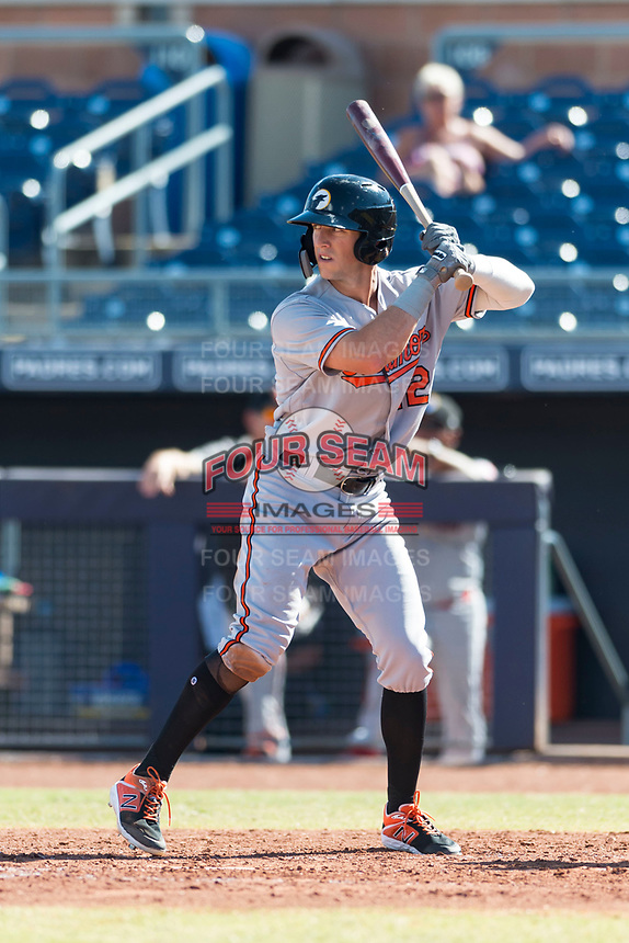 Glendale Desert Dogs second baseman Steve Wilkerson (12), of the Baltimore Orioles organization, at bat during an Arizona Fall League game against the Peoria Javelinas at Peoria Sports Complex on October 22, 2018 in Peoria, Arizona. Glendale defeated Peoria 6-2. (Zachary Lucy/Four Seam Images)