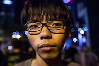 Seventeen year old student leader Joshua Wong is seen outside the Hong Kong government offices on the second day of the mass civil disobedience campaign Occupy Hong Kong, Admiralty, China, 30 September 2014. The movement is also being dubbed the 'umbrella revolution' after the versatile umbrellas used to shield protesters from rain, sun - and police pepper spray.