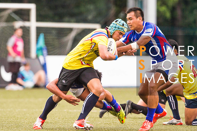 Thanakrit Booncharoen (l) of Thailand battles for the ball during the match between Chinese Taipei and Thailand of the Asia Rugby U20 Sevens Series 2016 on 12 August 2016 at the King's Park, in Hong Kong, China. Photo by Marcio Machado / Power Sport Images