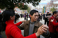 CHINA. Jiangxi Province.  Jiujiang. A couple dancing in a prk to keep fit.  Jiujiang is a city of 4.6 million people, located on the southern shore of the Yangtze River.  2008